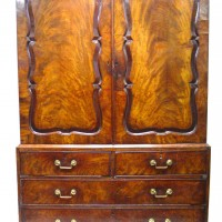 A George III Mahogany Linen Press. Hammer price: £1,750