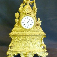 A 19th Century French Ormolu mantel clock Hammer: £440