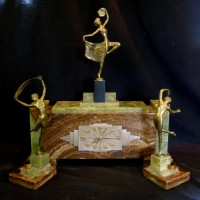 Art Deco marble and bronze three piece clock garniture, Lorenzl. Hammer: £1,800