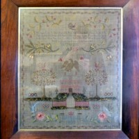 A William IV wool and silkwork sampler within a rosewood frame Hammer:  £850
