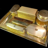 A 9ct gold dressing table set. Hammer: £11,000