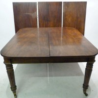 A William  IV figured mahogany pull out extending dining table. Hammer: £3200