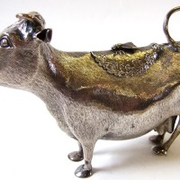 A George II  silver cow creamer by John Schuppe and dated 1758.