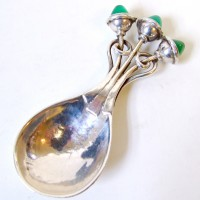 A small silver caddy spoon by Omar Ramsden. Hammer:  £3500
