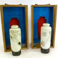 A pair of Chinese porcelain small vases Hammer: £53,000
