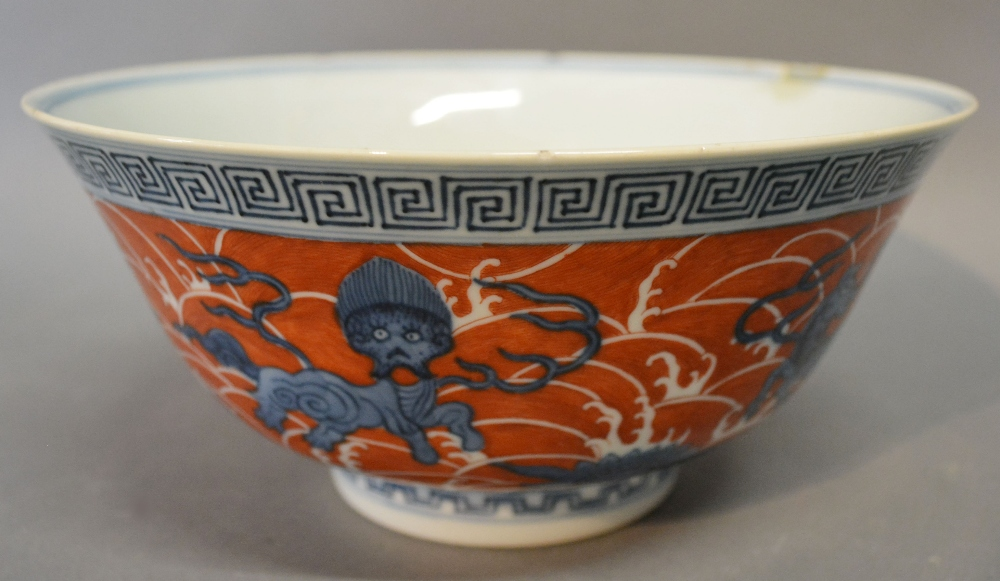 A Chinese Porcelain Bowl, decorated in underglaze blue and iron red, with Daoguang seal mark to base, 21 cms diameter Hammer: £2,700