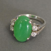 An 18 ct. White Gold, Jade and Diamond Ring Hammer £1800