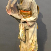 A Japanese Satsuma Porcelain Figure In The Form Of A Lady, decorated in polychrome enamels highlighted with gilt, seal mark to base, 60cm tall Hammer £620