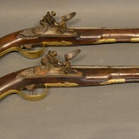 A Pair Of Late 18th Or Early 19th Century Probably Continental Flint Lock Pistols, with inlaid barrels and stocks, 22cm barrels Hammer; £2,500