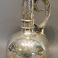 A Victorian Silver Jug Of Bottle Neck Form With Scroll Handle and engraved with storks amongst foliage, London 1879, retailed by the Goldsmiths Alliance Ltd, Cornhill London, 27oz, 26.5cm tall  Hammer: £500