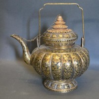 A Late 19th To Early 20th Century Teapot Of Lobed Form with an all over foliate design, 19cm tall Hammer: £7,000